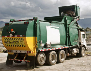 a garbage truck at a recycling facility