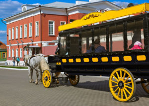 restored horse-drawn omnibus carrying tourists