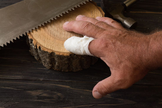Los Angeles amputation injury attorney can assist this worker whose finger was partially cut off with a saw