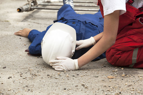 Los Angeles construction accident attorney can fight for this injured worker who is on the ground being assisted