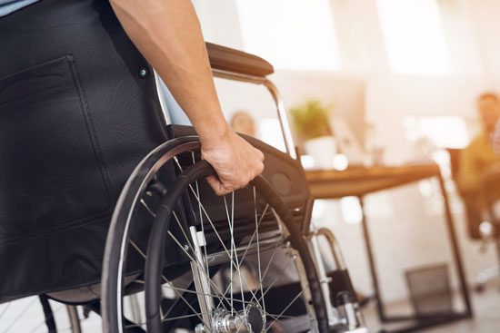 Los Angeles paralysis injury attorney will fight for this victim who is holding the wheel of his wheelchair