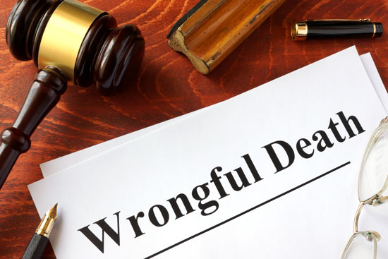 a gavel, pen, stamp, and a sign that says wrongful death on the desk of a Los Angeles wrongful death attorney
