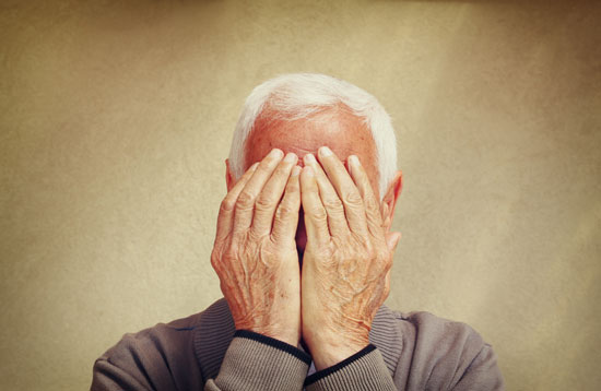 elderly gentleman covering his face with hands needs the nursing home neglect attorney Los Angeles trusts