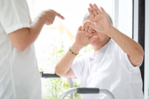 nursing home physical abuse attorney can assist this patient who is covering her face in fear of an angry nurse