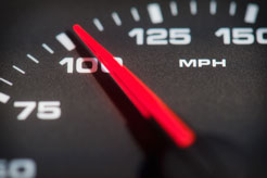 speedometer of a speeding car showing 100 miles per hour