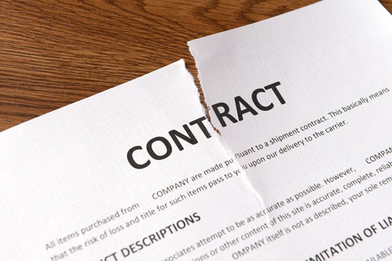 a torn apart contract on the desk of Los Angeles breach of contract lawyer