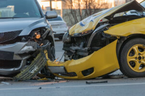 Los Angeles car accident attorney is ready to help victims of this crash between a yellow car and a silver car